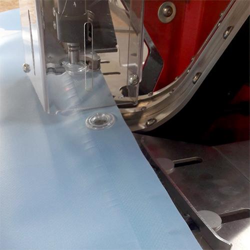 Occhiellatura striscioni PVC